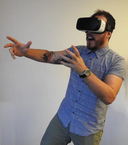 man-wearing-oculus-rift-to-enjoy-virtual-reality